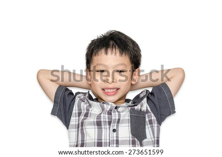 Top view of Asian boy smiles and lying on white background - stock photo
