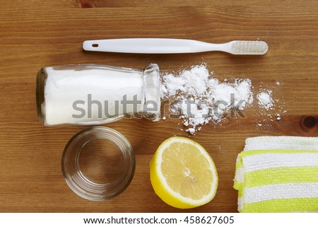 top view of baking soda with tooth brush and lemon
