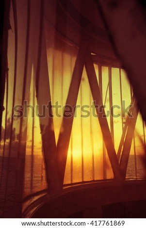 Top view of beach coast landscape at sunset from lighthouse balcony room window. - stock photo