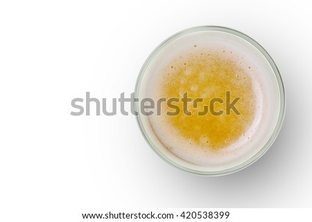 top view of beer bubbles in glass cup on white background. empty space for design. - stock photo