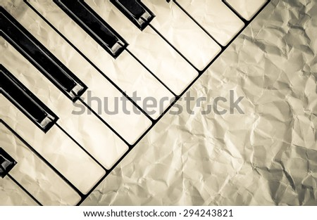 top view of black and white piano keys with  wrinkled paper filter in vintage color tone,music concept - stock photo