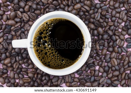 Top view of black coffee and coffee beans - stock photo