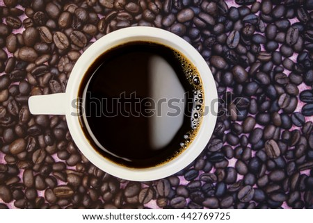 Top view of black coffee and coffee beans  - Vintage Filter - stock photo