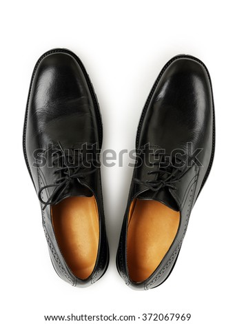 top view of black leather shoes on white