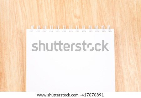 Top view of  blank open ring binder notebook on wood table,Business template mock up for adding your text. - stock photo