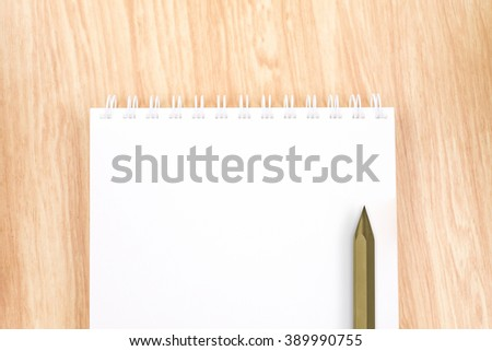 Top view of  blank open ring binder notebook with black pencil on wood table,Business template mock up for adding your text - stock photo