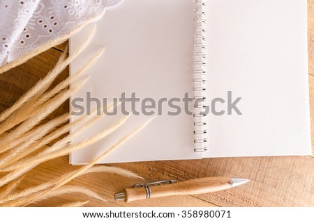 Top view of blank opened notebook page on a wooden table - stock photo