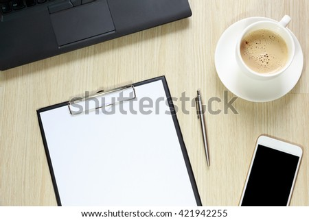Top view of blank sheet on office desk  with computer, smartphone,stationery and coffee concept