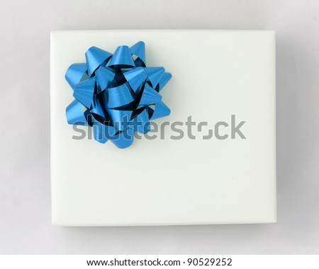Top view of Blue star ribbon on White paper box, Gift for Special Day - stock photo