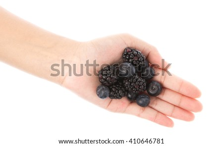 top view of blueberry and blackberry fruit in hands isolated on white background