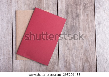 Top view of book on old wooden plank background - stock photo