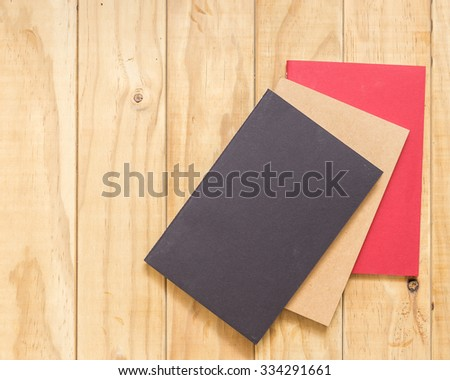 Top view of book on wooden table background - stock photo