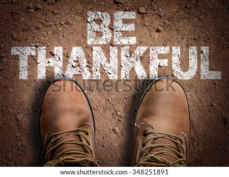 Top View of Boot on the trail with the text: Be Thankful - stock photo
