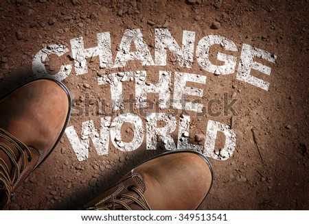 Top View of Boot on the trail with the text: Change the World - stock photo