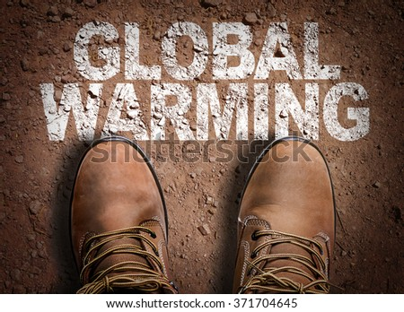 Top View of Boot on the trail with the text: Global Warming - stock photo
