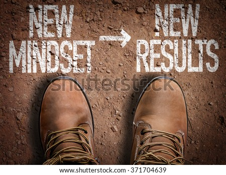 Top View of Boot on the trail with the text: New Mindset - New Results - stock photo