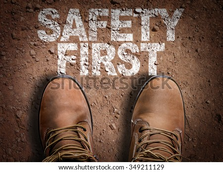 Top View of Boot on the trail with the text: Safety First - stock photo