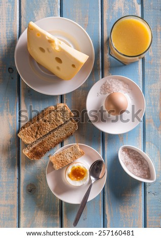 Top view of breakfast on wooden board - stock photo