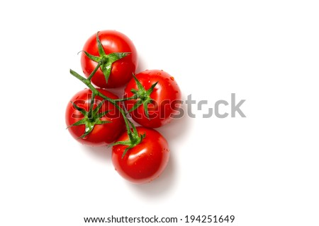Top view of bunch of fresh tomatoes isolated on white background  - stock photo