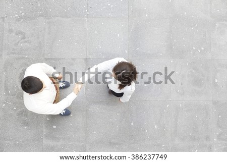 Top view of business partners shaking hands  - stock photo