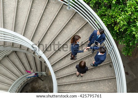 Top view of business people at staircase - stock photo