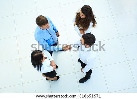 Top view of business people shaking hands, finishing up a meeting - Welcome to business - stock photo