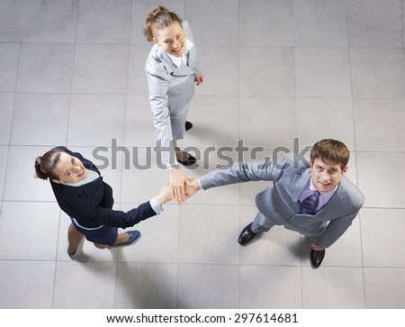 Top view of business people uniting hands in pile - stock photo