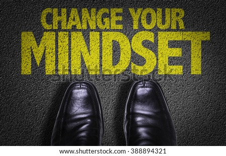 Top View of Business Shoes on the floor with the text: Change Your Mindset - stock photo