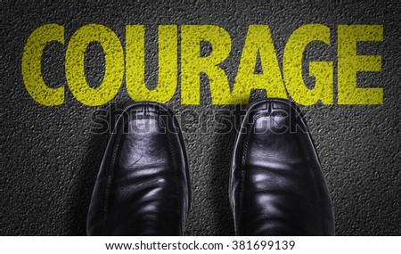 Top View of Business Shoes on the floor with the text: Courage - stock photo