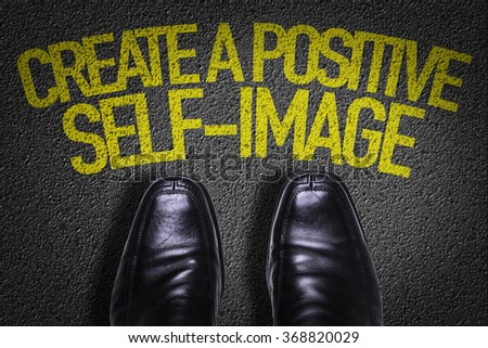 Top View of Business Shoes on the floor with the text: Create a Positive Self-Image - stock photo