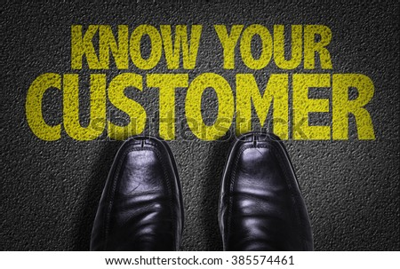 Top View of Business Shoes on the floor with the text: Know Your Customer - stock photo