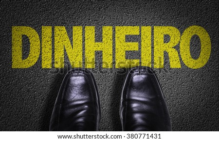 Top View of Business Shoes on the floor with the text: Money (in Portuguese) - stock photo