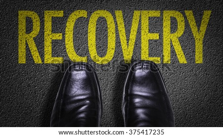 Top View of Business Shoes on the floor with the text: Recovery - stock photo