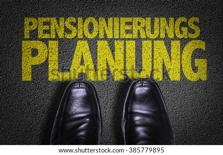 Top View of Business Shoes on the floor with the text: Retirement Planning (in German) - stock photo
