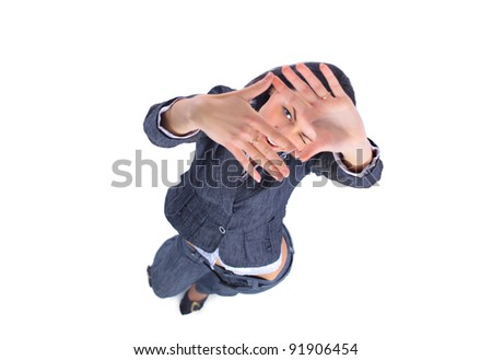 Top view of business woman looking through a hand frame over white - stock photo