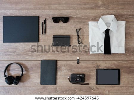 top view of businessman clothes isolated on wooden background - stock photo