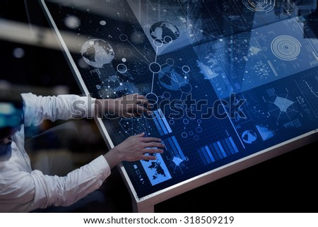 top view of businessman hand working with modern technology and digital layer effect as business strategy concept - stock photo