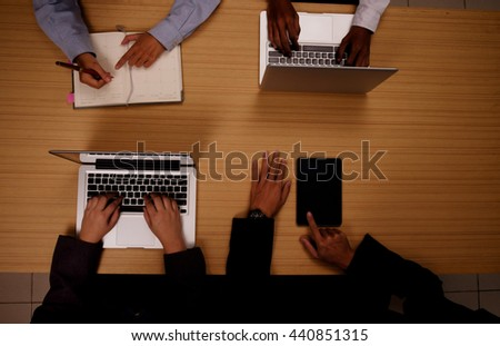 Top view of businessman hand working with new modern computer tablet and notebook, Young creative team working together, People Meeting Design Ideas Concept,vintage color. Business concept.