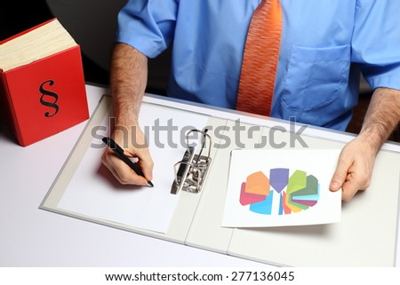 top-view of businessman working on documents at desk - stock photo