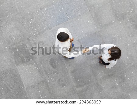 Top view of businesspeople shaking hands  - stock photo