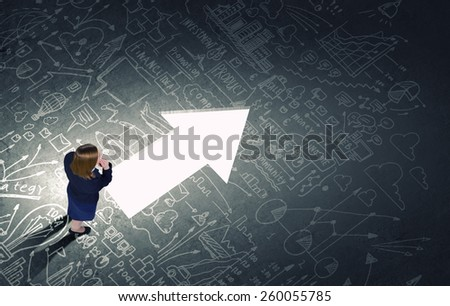 Top view of businesswoman looking at business sketches