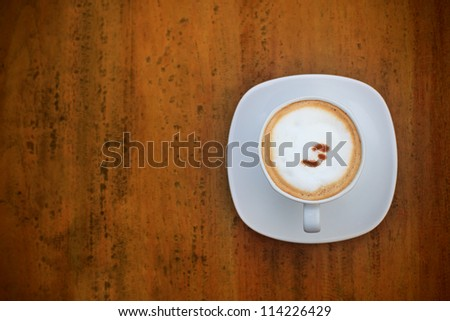 top view of cappuccino coffee dress up  in white cup - stock photo