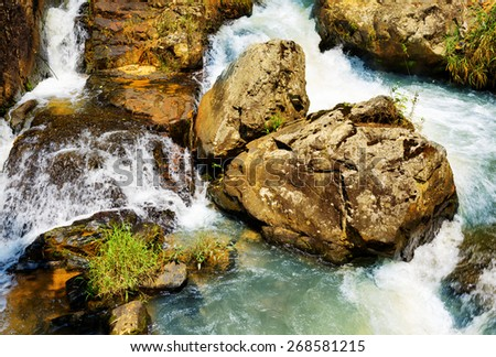 Top view of cascade on the Datanla waterfall in Da Lat city (Dalat), Vietnam. Da Lat and the surrounding area is a popular tourist destination of Asia. - stock photo