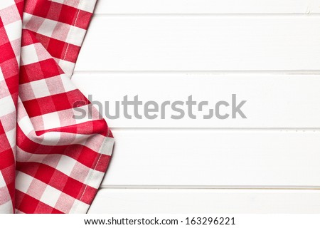 top view of checkered napkin on white wooden table - stock photo