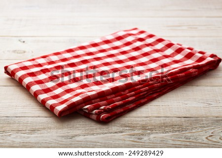 Top view of checkered napkin tablecloth on white wooden table. Unique perspectives horizontal - stock photo