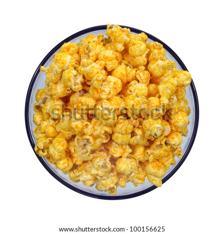 Top view of cheese flavored popcorn in a blue bowl on a white background. - stock photo