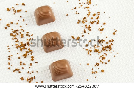 Top view of chocolate pralines on white towel - stock photo