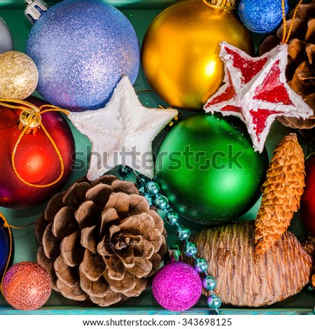 top view of Christmas decoration, tinsel,  pinecones, stars and balls like  background, closeup