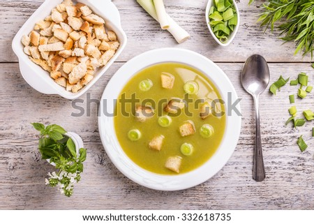 Top view of classic leek and potato soup - stock photo