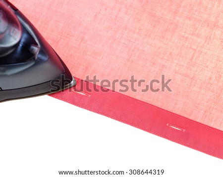 top view of clothing iron ironing red shirt isolated on white background